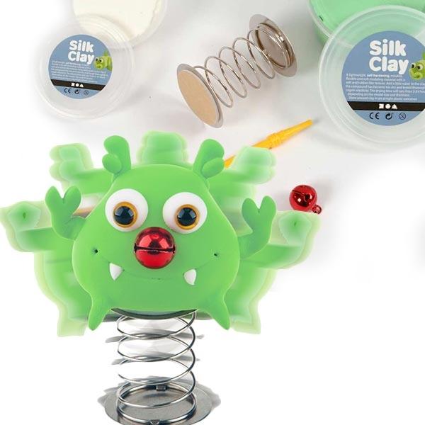 Silk Clay, Grünes Knetmonster, mit Feder und Glocke